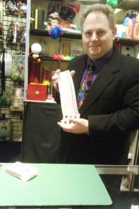 Ronald Diamond performs a card trick at the Ronjo magic shop. Photo by Jenni Culkin
