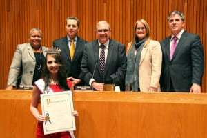 Rachel Goldsmith, Miss Teen New York International, receives a proclamation earlier this year from the Town of Huntington Board of Trustees, from left, Councilwoman Tracey Edwards (D); Councilman Mark Cuthbertson (D); Supervisor Frank Petrone (D), Councilwoman Susan A. Berland (D) and Councilman Gene Cook (I). Photo from Town of Huntington
