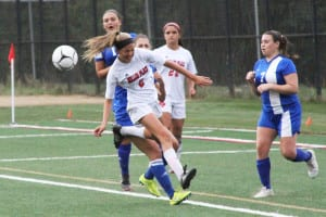 Miller Place's Olivia Angelo heads the ball. Photo by Desirée Keegan