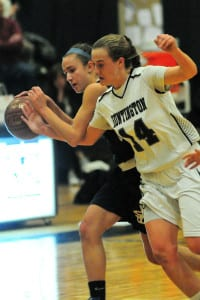 Huntington's Taylor Moreno tries to force a turnover from Smithtown's Jillian Unkenholz. Photo by Bill Landon
