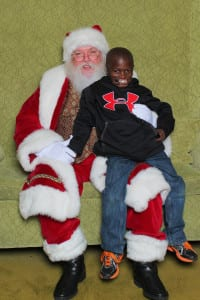 Dunia Sibomana meets Santa Claus. Photo from Amy Epstein