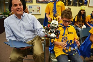 Steven Nielsen shows off the creation of the Robotic Raccoons, Comsewogue's middle school team. Photo by Alex Petroski