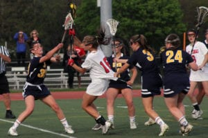 Mount Sinai's Caroline Hoeg scores over Shoreham's Sophia Triandafils. Photo by Desirée Keegan