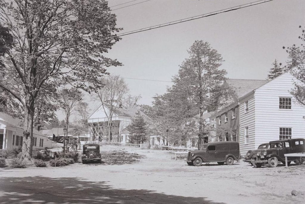 A photo captures construction underway at the Stony Brook Village Center in 1940. Photo from the WMHO
