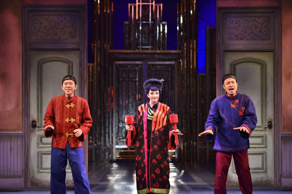 "Anthony Chan (as Ching Ho), Michele Ragusa (as Mrs. Meers) and Carl Hsu (as Bun Foo) sing ""Muqin"" in a scene from 'Thoroughly Modern Millie.' Photo by Michael DeCristofaro"