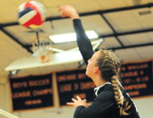 Kings Park's Lauren Kloos tallies a kill. Photo by Bill Landon