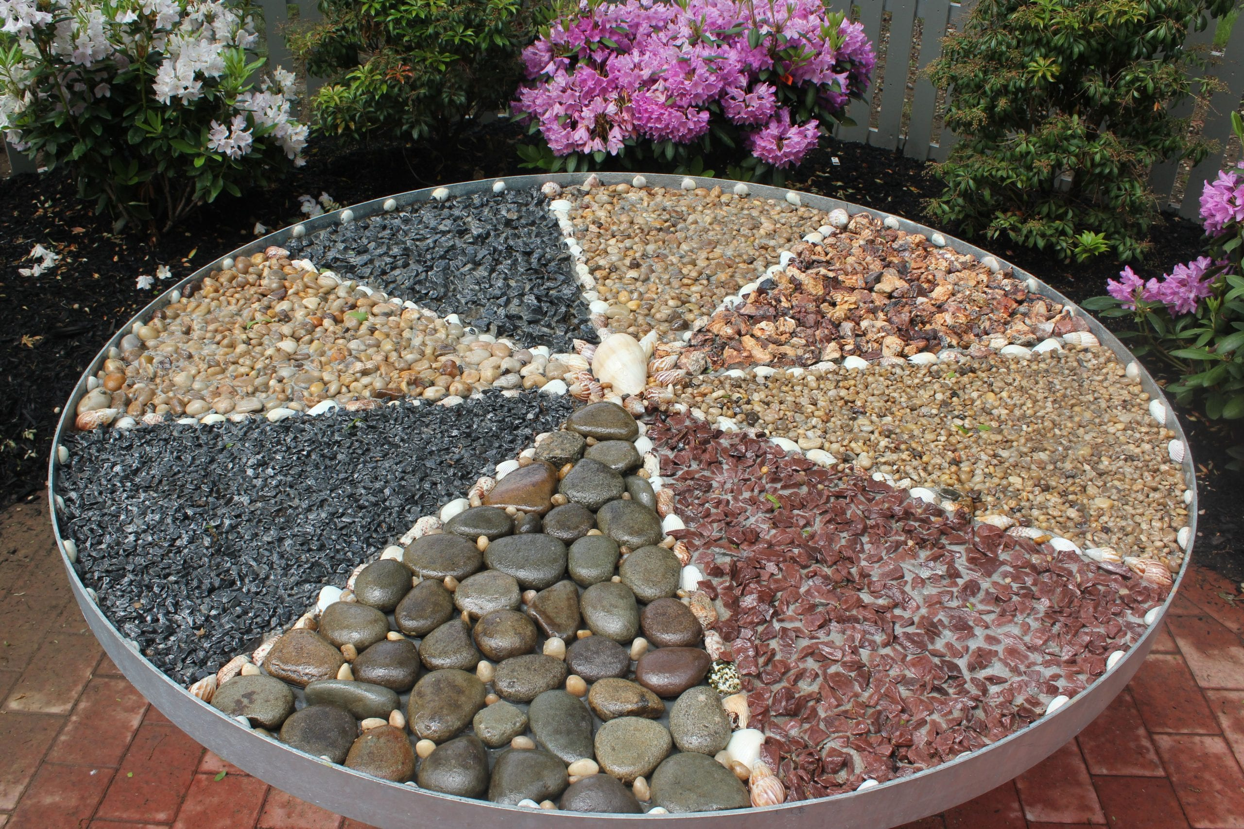 a sensory wheel filled with rocks is housed in the touch section of ahrc suffolks new sensory garden in shoreham photo by kevin redding - Sensory Garden