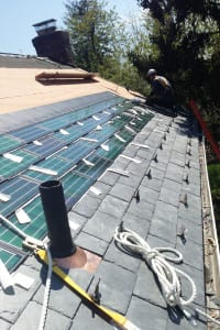 Solar shingles are installed onto the roof of a Long Island residence. Photo from Division 7