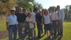 Friends, family and town officials gather to remember Maggie Rosales, Danny Carbajal and Sarah Strobel in Huntington Station on Thursday. Three trees were planted in their honor. Photo by Mary Beth Steenson Kraese