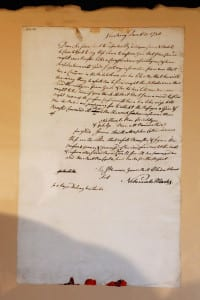 A historic letter detailing the involvement of Port Jefferson brothers in George Washington's Culper Spy Ring is on display at the Drowned Meadow Cottage. Photo by Giselle Barkley