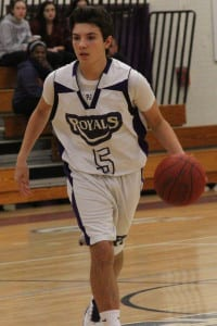 Port Jefferson sophomore Thomas Mark dribbles the ball through mid court in the Royals' 60-58 win over Greenport on Dec. 18. Photo by Desirée Keegan