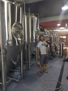 Sand City Brewing Co. owner Kevin Sihler and his son, Hudson, pose inside the brewery. Photo from Sihler