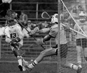 Tom Rotanz makes a save during a Ward Melville boys' lacrosse game. He helped the team to two Long Island championship titles and a New York State championship appearance. Photo from Tom Rotanz