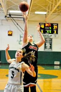 Mount Sinai's Veronica Venezia shoots from the top of the key. Photo by Bill Landon