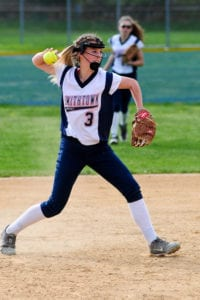 Freshman utility player Gabrianna Lorefice fires the ball to first base. Photo by Bill Landon