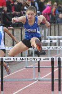 Tori Reid leaps over a hurdle during the St. Anthony's Invitational. Photo from Reid