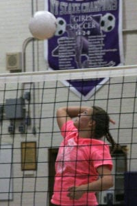 Junior Izzie Love leaps up for a spike. Photo by Desirée Keegan